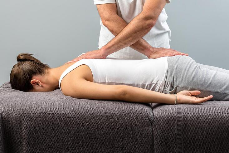 chiropractor-working-on-woman-s-back