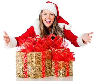 Beautiful Female Santa with Christmas gifts â?? isolated over a white background