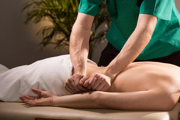 Close-up of physical therapist doing medical massage