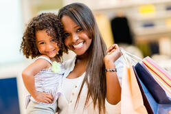 Happy mother and daughter shopping at a retail store