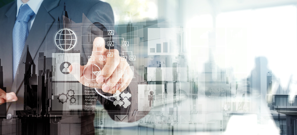 Double exposure of  businessman hand working with new modern computer and business strategy as concept-1